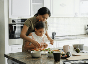 mom and daughter making food at home