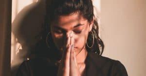 praying young woman
